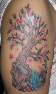 Tree tattoo with pink flowers and stream
