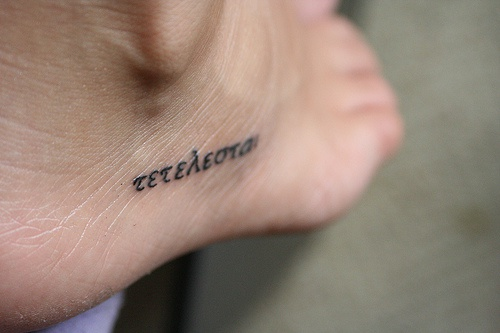 Narrow inscription like a code foot tattoo