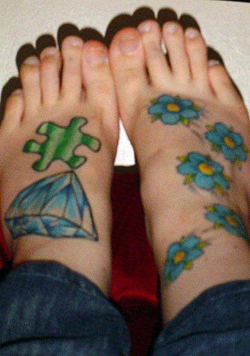 Brilliant, puzzle & flowers foot tattoo