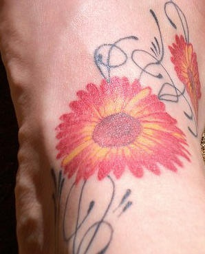 Red parti-coloured flowers foot tattoo