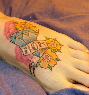Brilliant love to mom with flowers foot tattoo