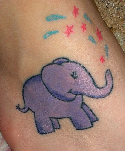 Merry elephant with drops and stars foot tattoo