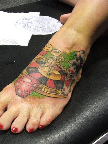 Devil&quots books & roulette  in casino foot tattoo