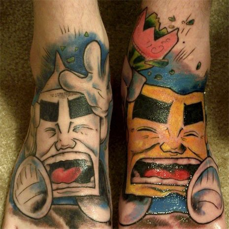 Shouting white & yellow stones foot tattoo