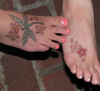 Green dragonfly and red flowers  foot tattoo