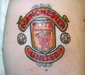 Manchester united crest tattoo