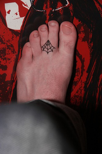 Little cobweb between toes foot tattoo