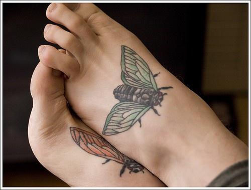 Realistic flies , green & red foot tattoo