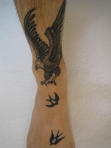 Hawk catching swallows in flight foot tattoo