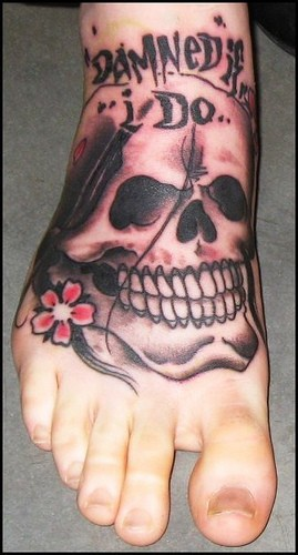 Laughing skull:damned if i do.foot tattoo