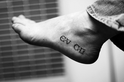 Foreign letters with meaning foot tattoo