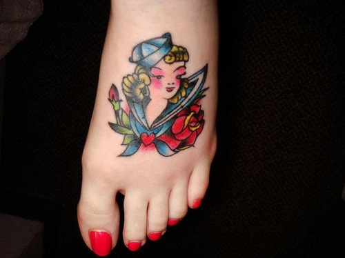Lovely blond sea-girl foot tattoo