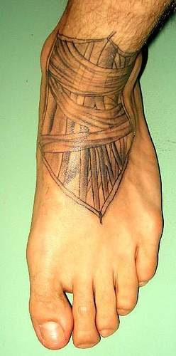 Thick wicker black shield foot tattoo