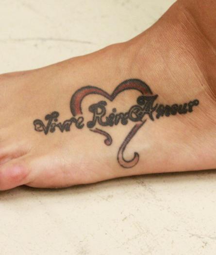 Love styled inscription in heart foot tattoo