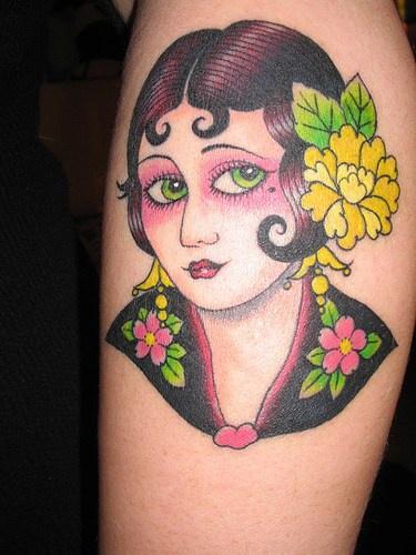 Innocent geisha with make-up forearm tattoo