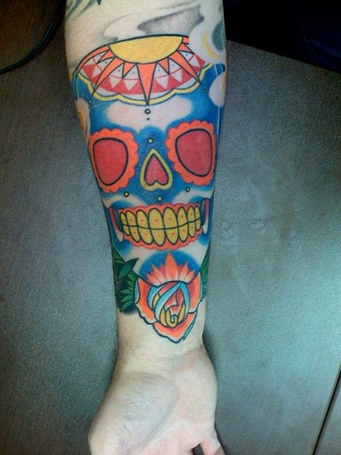 Picturesque, fantastic, laughing skull forearm tattoo