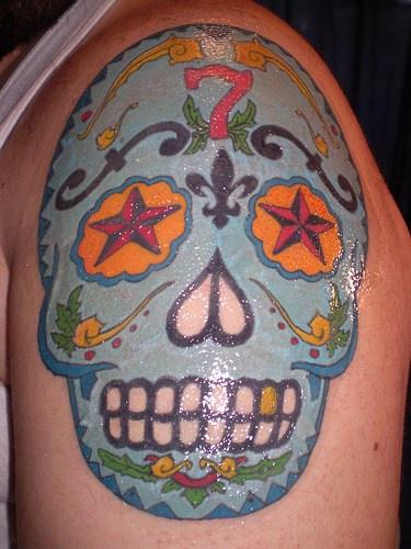 Blue dia de muertos skull tattoo on shoulder