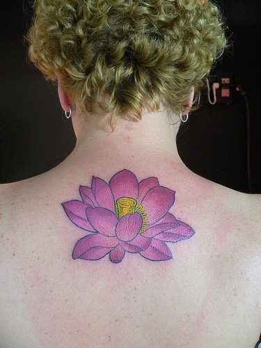 Purple flower tattoo on back