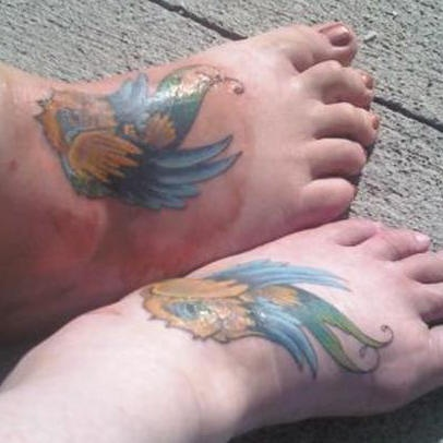 Identical sparrow tattoos on feet