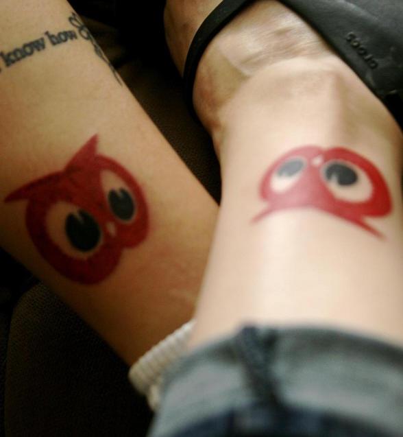 Identical owl tattoos on friends