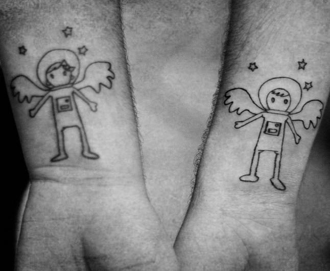 Astronaut boy and girl wrist tattoos