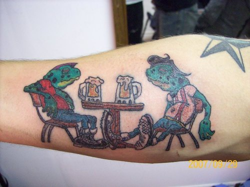 Frogs drinking beer on arm