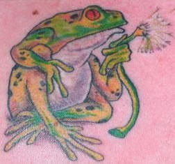 Frog with dandelion tattoo
