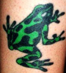 Green and black dotted frog tattoo