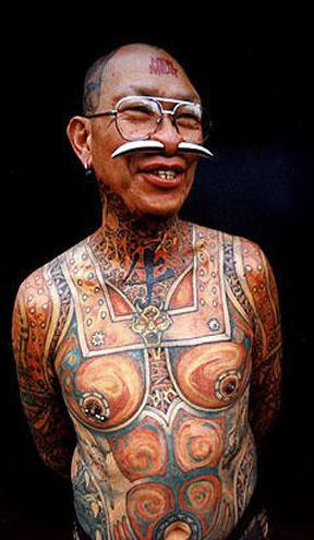 Full body and face tattooed