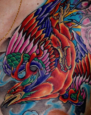 Amazing colourful phoenix artwork tattoo