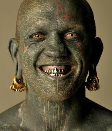 Green full tattooed face