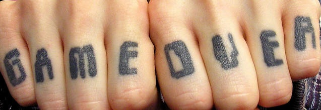 Knuckle tattoo,game over, big black letters