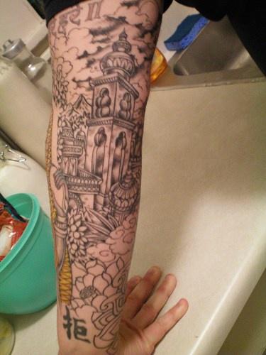 Pagoda complex black ink tattoo