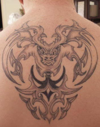 Gargoyle with tribal tracery tattoo