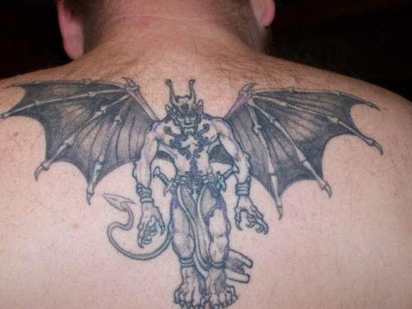 Humanised winged demon tattoo on back
