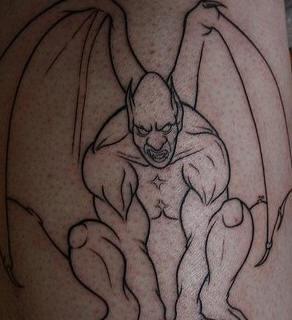Black line humanised gargoyle tattoo