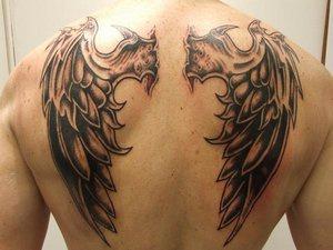Gargoyle wings tattoo on back