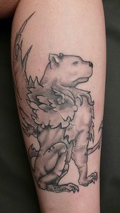 Gryphon with polar bear head tattoo