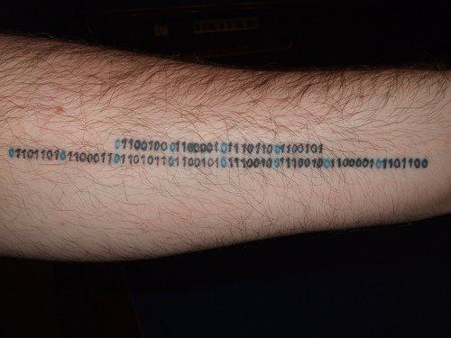 Binary code arm tattoo