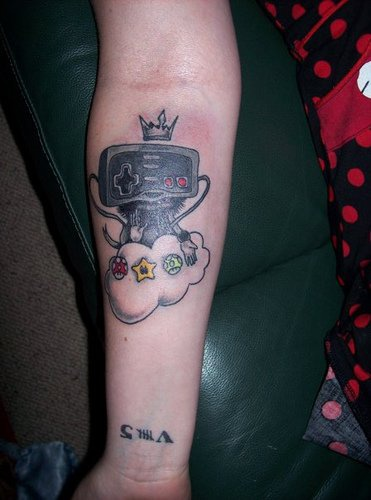 Nintendo joystick heaven tattoo on arm