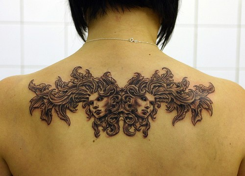 Mythical tracery tattoo on back
