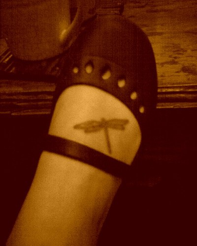 Little realistic dragonfly tattoo on foot