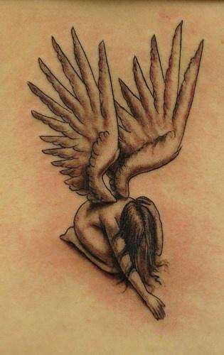 Volumetric angel in sorrow tattoo