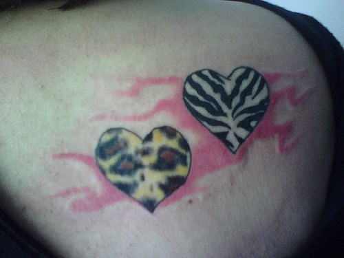 Zebra and leopard textured hearts tattoo