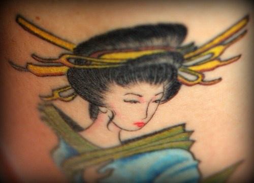 Colourful geisha girl tattoo