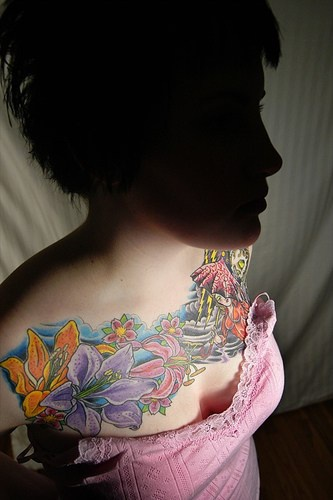 Colourful bunch of sea flowers tattoo on chest