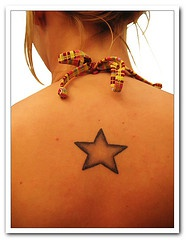 Black gradient star tattoo