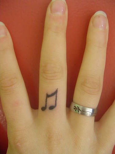 Musical note finger tattoo - Tattooimages.biz