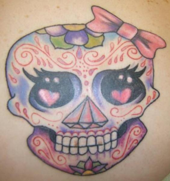 Girly sugar skull with bow tattoo