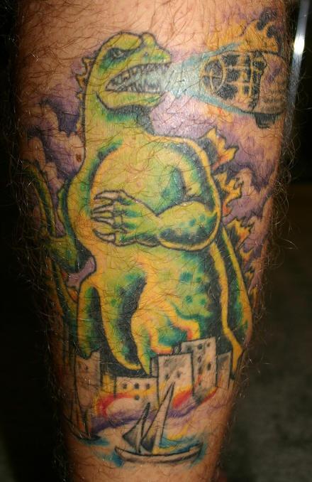 Leg tattoo, great shouting godzilla in city